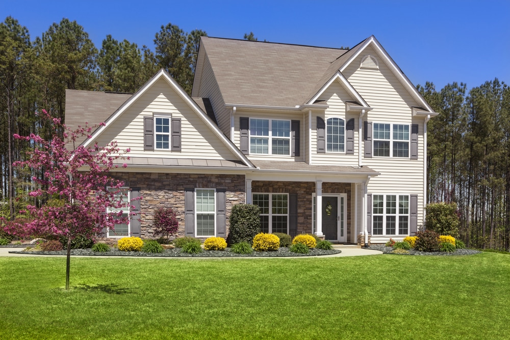 Beige Home with a Grassy Lawn